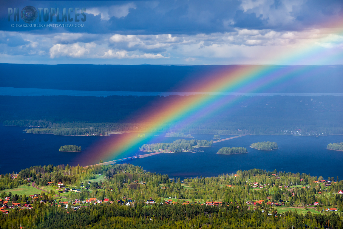 View from Gesundaberget hill to bridge to Solleron island with rainbow